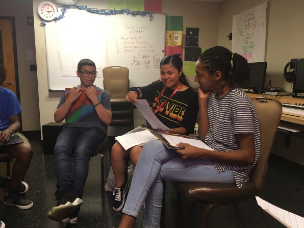 Students rehearsing scripts